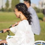 riding bicycles along the seawall for an engagement session at vanier park by vancouver wedding photographers www.lovetreephotography.ca