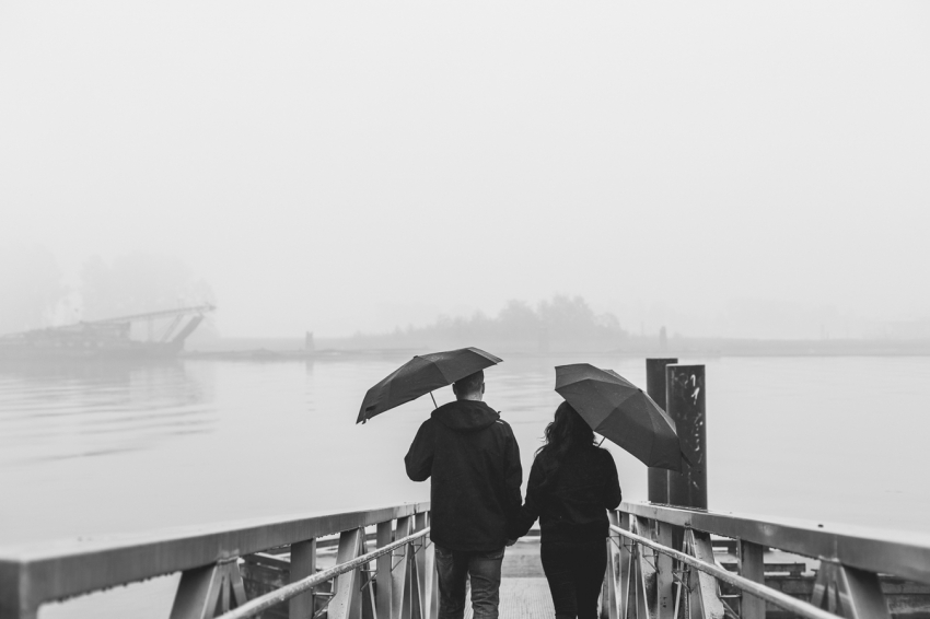 rainy day portrait of a couple on the pier in new westminster