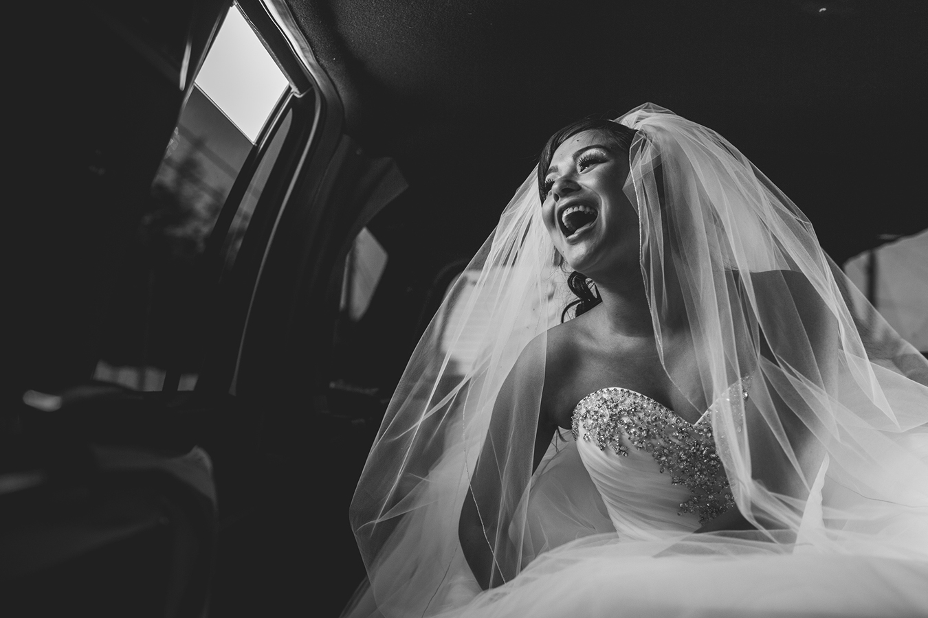 bride laughing in limo