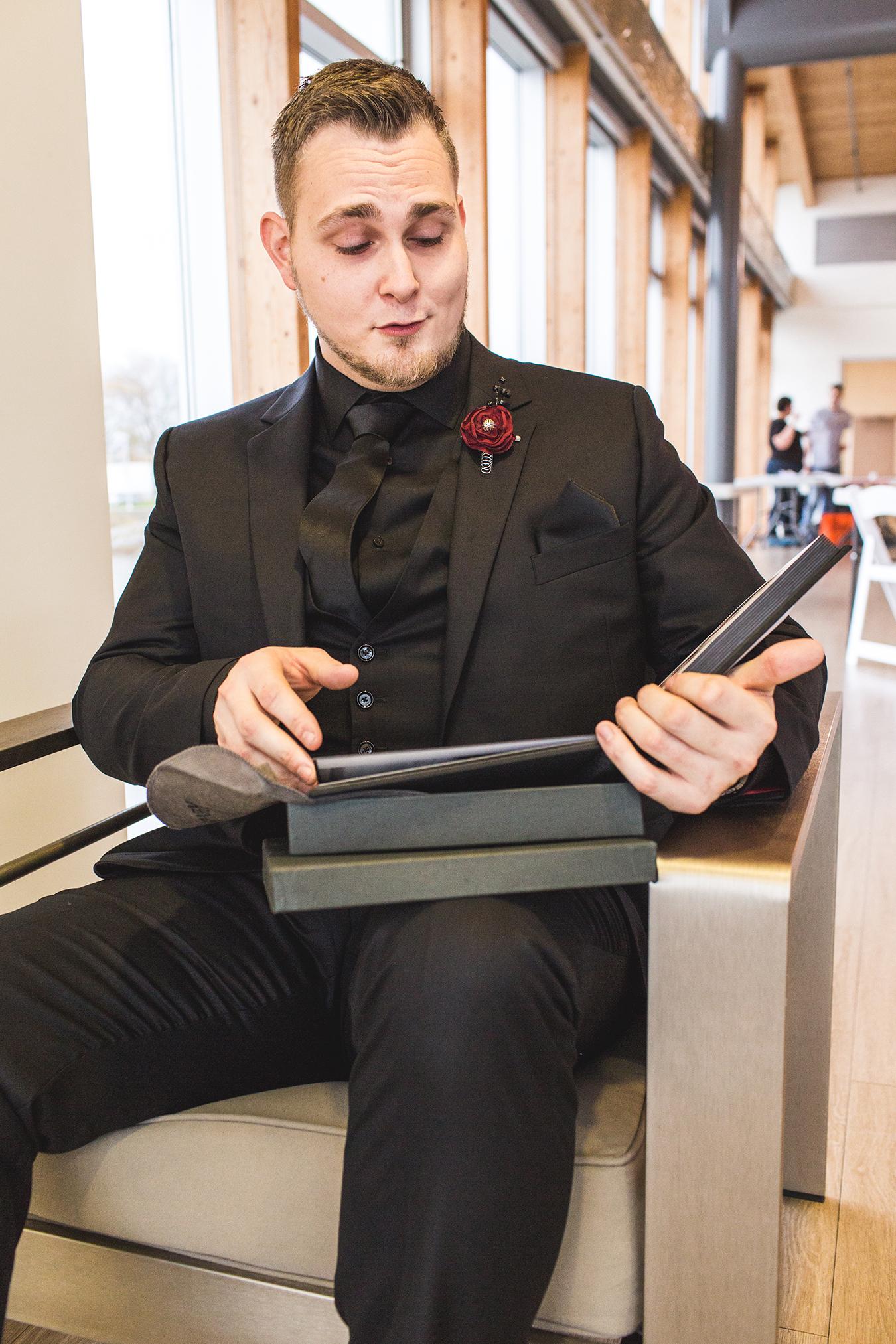 groom reacts to bridal boudoir album