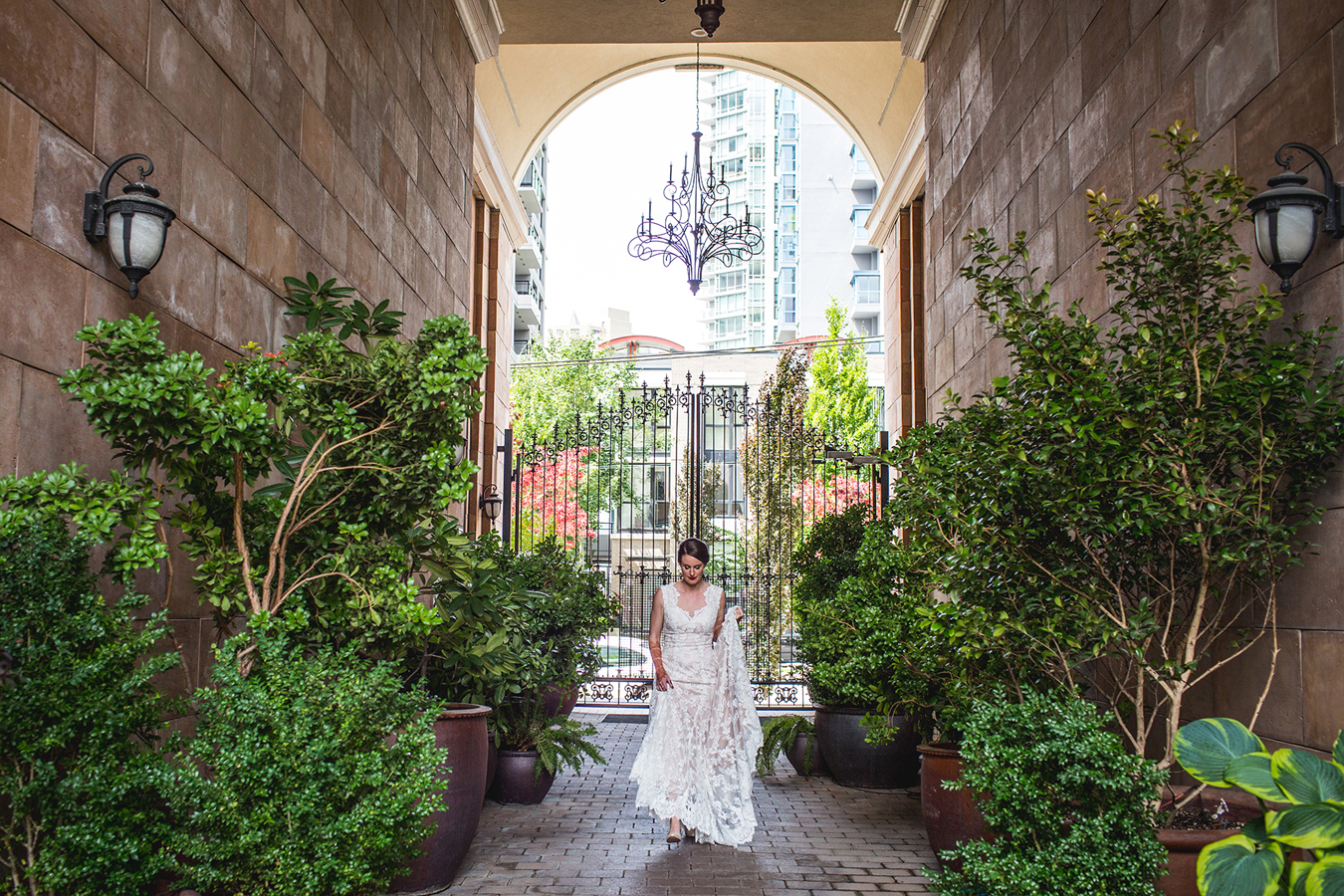 bride walks to her first look in Yaletown Vancouver
