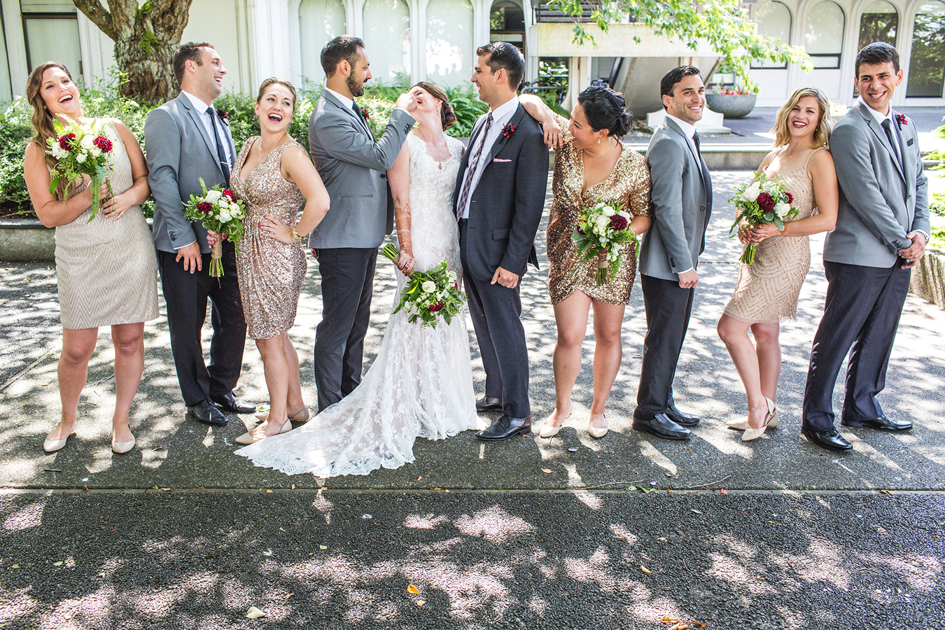 Bridal party laughing together at Vanier Park in Vancouver