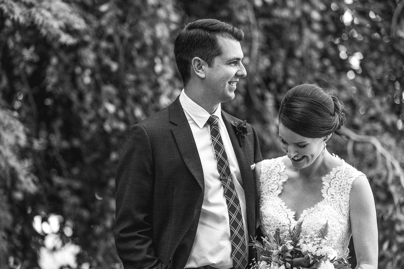 candid portrait of bride and groom laughing together at Vanier Park in Vancouver
