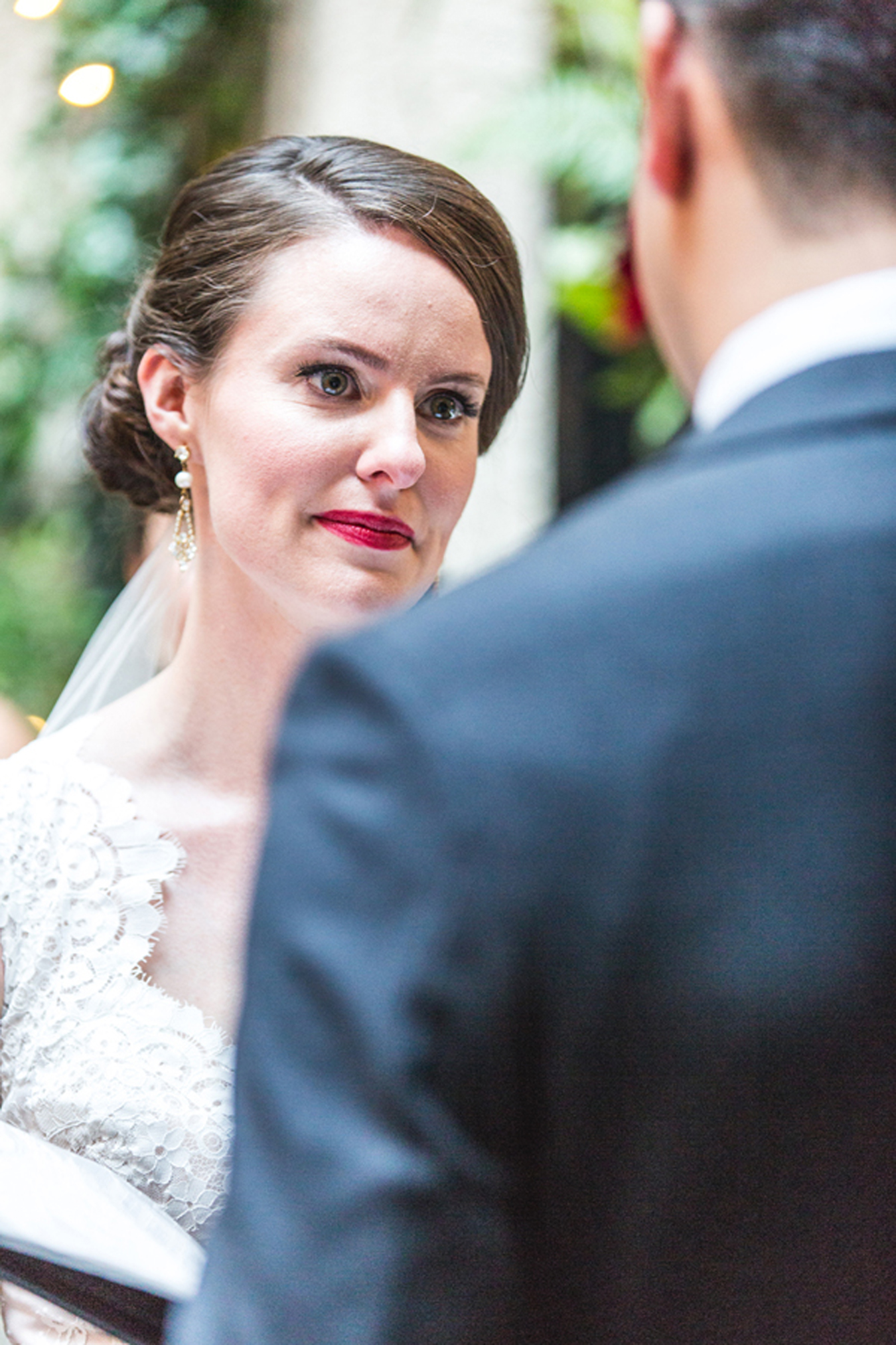 bride's eyes well with tears as she listens to her husband's vows