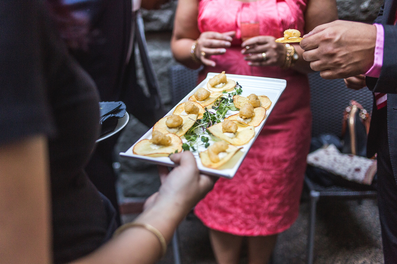 Fish and chip appetizers are handed out during the cocktail hour at a wedding in Yaletown