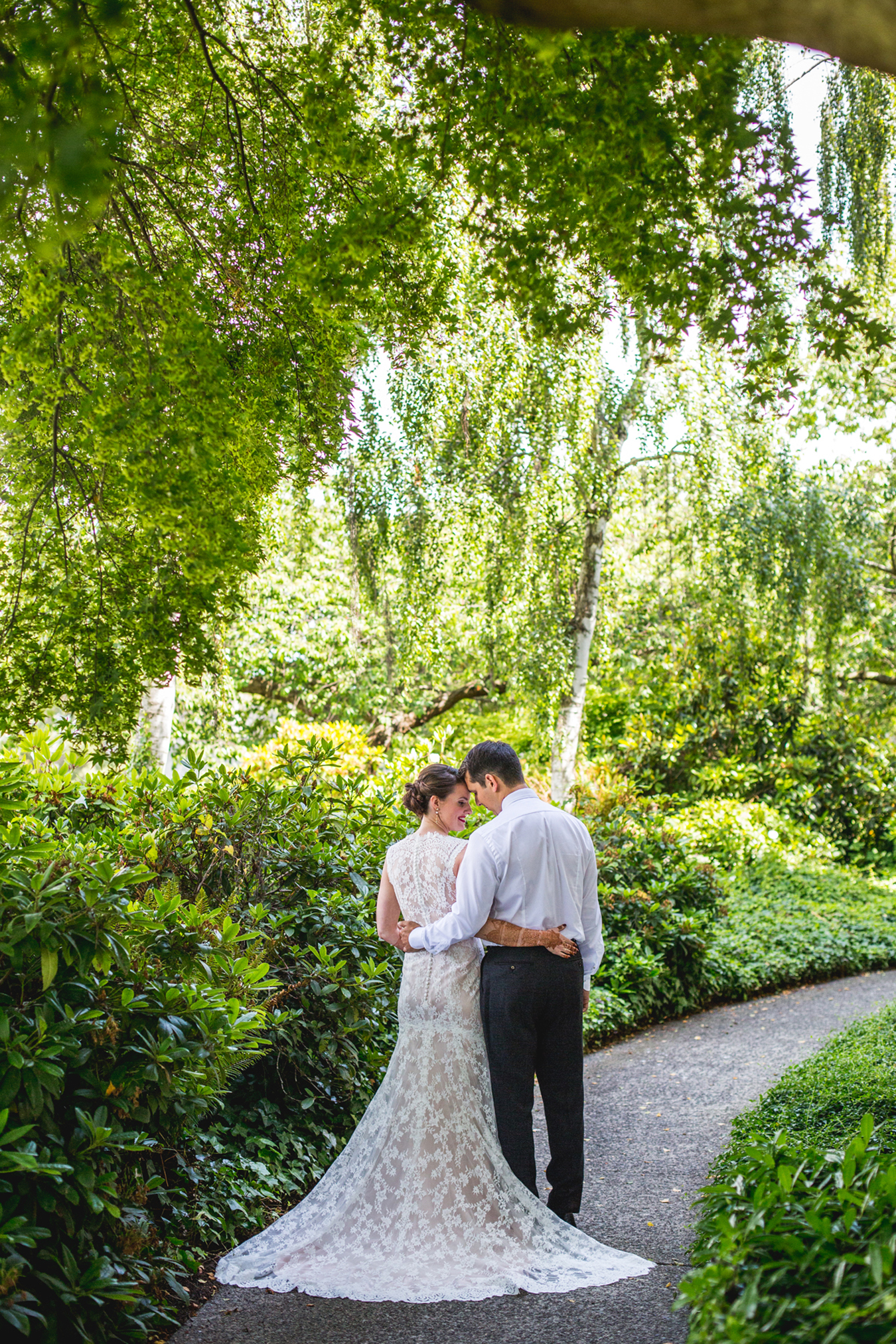 A wedding portrait at the gardens outside of the Museum of Vancouver