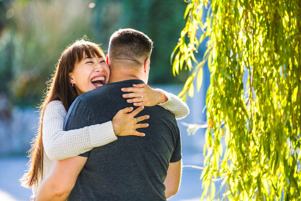 engagement portrait of a couple laughing together