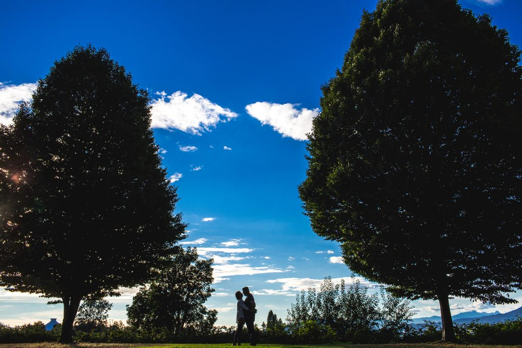 A silhouette of a couple against the sky in Vancouver BC