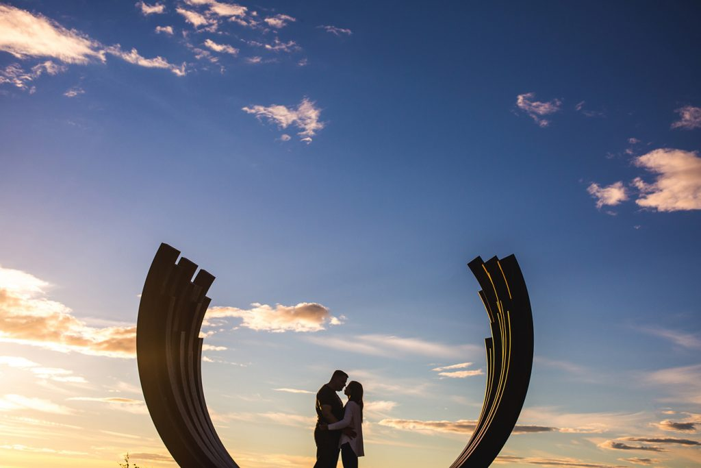 Silhouette of a couple in the 217.5 Arc X 13 by Bernar Venet