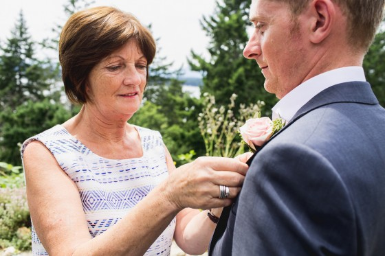 Mom pinning on the boutonniere