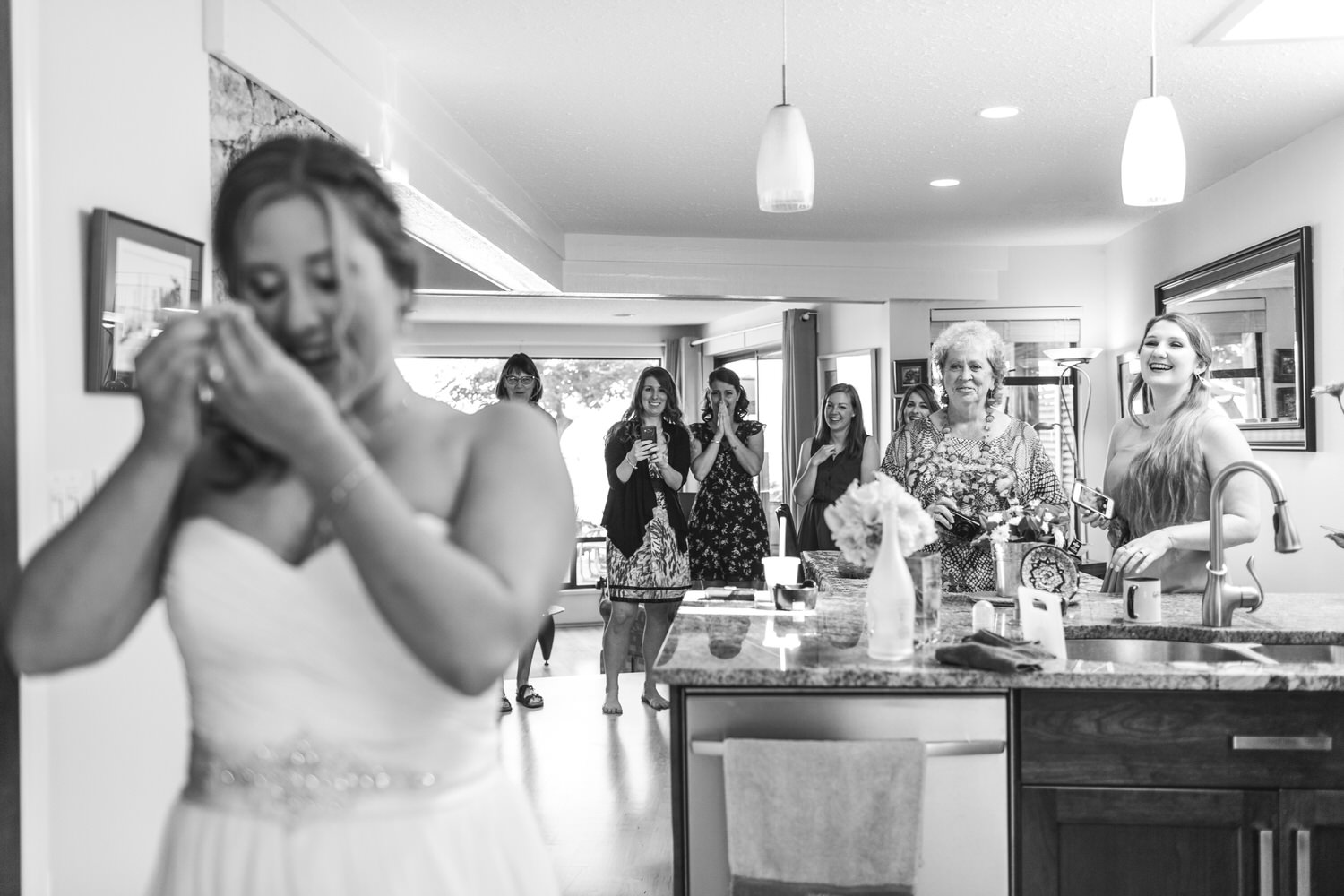 emotional bride cries as her friends see her for the first time