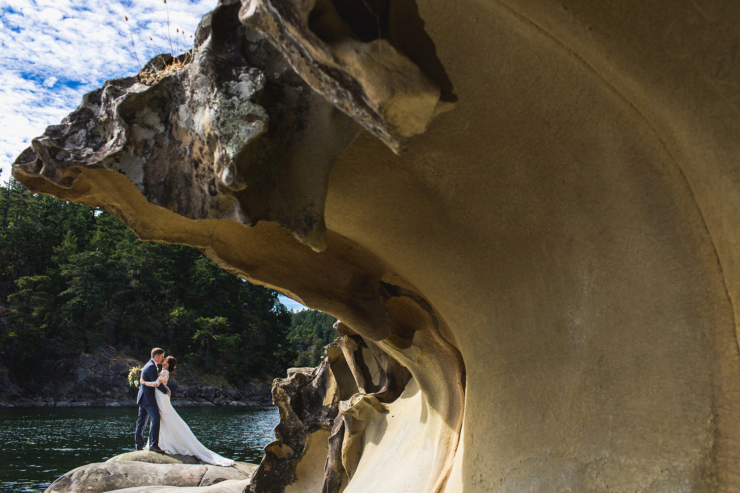 A bride and groom kissing at Retreat Cove
