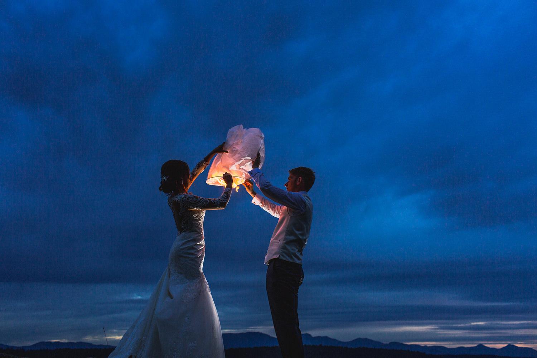 Newlyweds light a wedding lantern