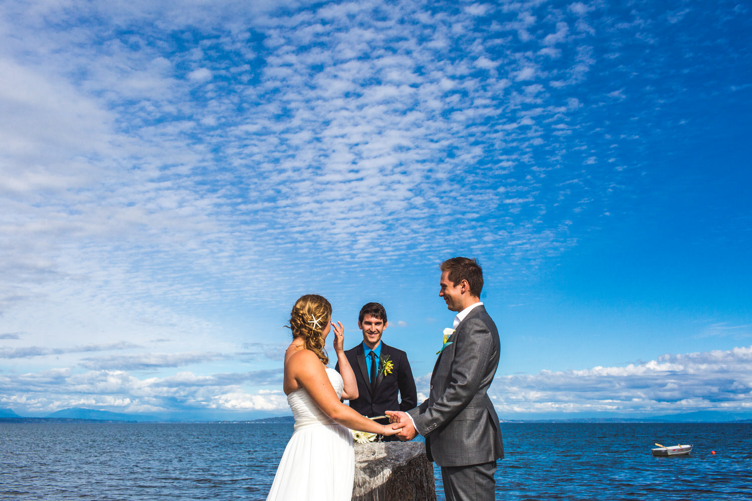 bride and groom next to ocean for beach wedding ceremony