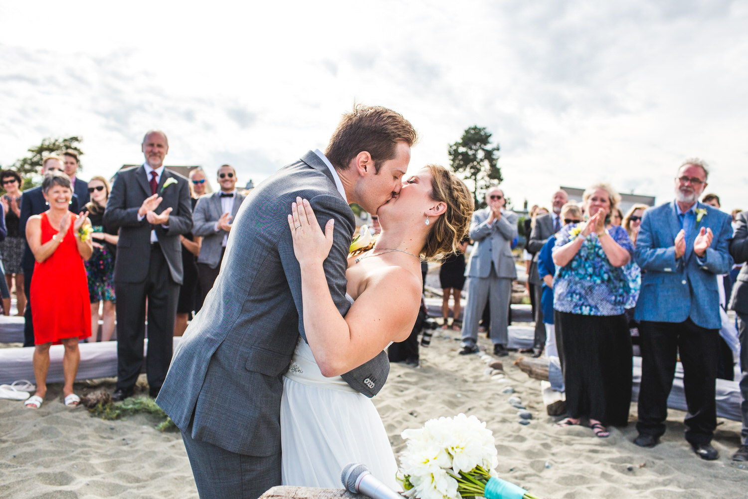 Bride and groom kiss at Centennial Beach wedding
