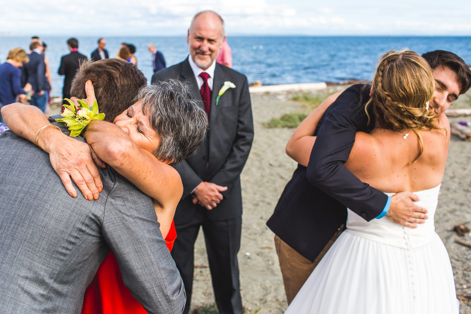 parents hugging newlyweds